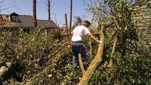 IMAG2778 april 29 Tanya Mikulas with a chainsaw Tuscaloosa tornado 2011