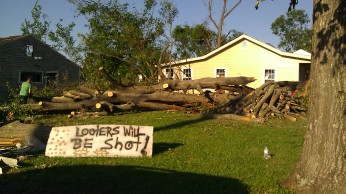 """Looters will be shot"" sign. Tanya Mikulas, photographer."