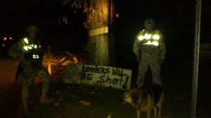 Night patrol with my 'looters will be shot' sign. Tanya Mikulas, photographer.
