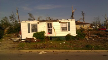 House blown off the foundation and roof torn away. Tanya Mikulas, photographer.