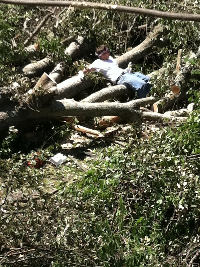 Tanya Mikulas in a pile of tornado debris, April 29, 2011.